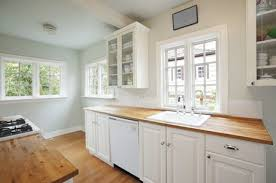small kitchen cabinets pictures gallery painting strategies that make a small kitchen look larger