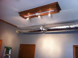 replace fluorescent light fixture with track lighting diy track lighting installed on the previous fluorescent light box