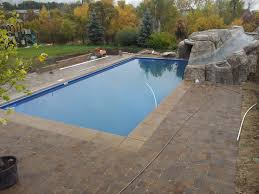 Landscaping Around Pools by Backyard Swimming Pool Diving And Jumping Faux Rock And Cave