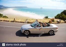 family car side view south africa cape town family man driving silver convertible car
