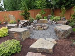 backyard landscaping ideas with fire pit bench plus stone blocks