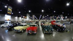 auto bid auction mecum car auction roars into denver enthusiasts ogle some bid