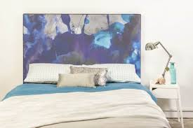 painted headboard abstract painted headboard in the bedroom with white walls a
