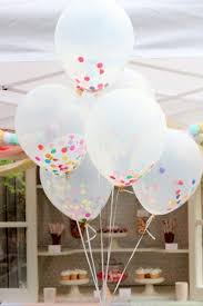 large white balloons fill clear balloons with large confetti for and