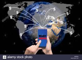 hand holding smart phone sent money dollar bills flying away from