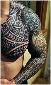 black ink tribal tattoo on side of stomach
