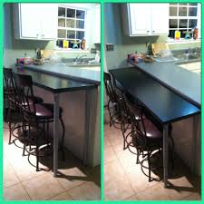 diy breakfast bar all i did was bought a butchers block counter you can purchase the butchers block counter top and adjustable legs from ikea cut the counter top to the width desired add the legs sand stain