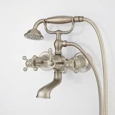 parlington wall mount tub faucet with cross handles and