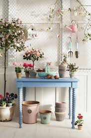 blue table white wooden wall ceramic flooring tile flower on pot