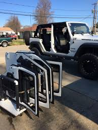 white jeep 4 door jeep unlimited with 35 tires 18x10 black white fortec jeep