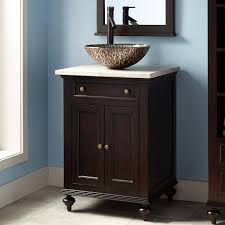 24 the dark espresso finish on the keller mahogany vessel sink vanity creates a warm look in your half bathroom