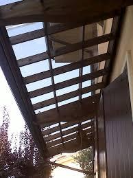 tettoie in legno e vetro pensiline policarbonato verona pensiline in vetro copriporta verona