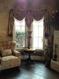 round room swags and jabot with tassel trim faux finished wall round room bowed wall with swags and cascades and center jabot with tassel trim faux finished wall treatment old world