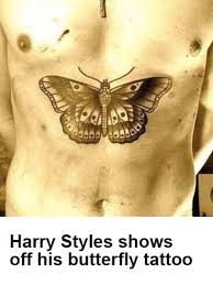harry styles shock his butterfly ink is