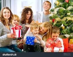 At Home Christmas Trees by Happy Big Family Holding Christmas Presents Stock Photo 89455489