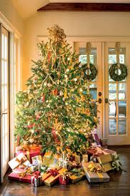 how to wrap christmas lights around a tree easy ways to decorate with twinkle lights southern living