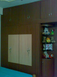 Bedroom Wardrobe Latest Designs by White Lacquer Modern Wardrobe Design Come With Wooden Material