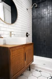 best ideas about black subway tiles pinterest tile vintage wood vanity serves sink this beautiful black and white bathroom remodel honeycomb tiles with subway tile walls vertically
