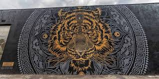 corporate partnerships beautify earth tiger mural
