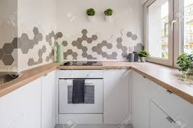wall tiles for white kitchen cabinets kitchen in scandinavian style with white cabinets wooden countertop