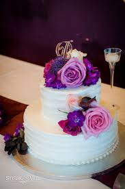 two tier wedding cake white cake purple flowers roses