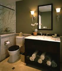 elegant powder room with black vanity marble tile sage green