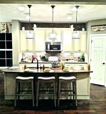 lights for island kitchen chandelier lighting kitchen island kevinsweeney me