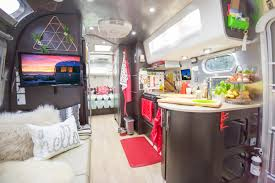 exotic airstream interior design with wooden furnishing and modern