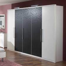 Schlafzimmerschrank Mit Tv Kleiderschrank Setian In Schwarz Weiß Mit Muster Pharao24 De