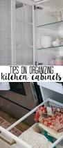 tips on organizing kitchen cabinets at home with ashley