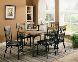 Cushioned Dining Chairs Furniture Rectangle Wooden Top Table Surrounded By 6 Black Metal