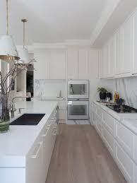 Creamy White Kitchen Cabinets Stunning Kitchen With Creamy White Cabinets Paired With Calcutta