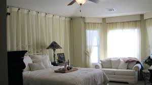 curtain over bed hanging curtains over bed large size of curtain hanging curtains