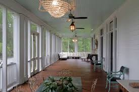 exterior design white lap siding and sun porch furniture with