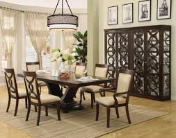 beautiful large dining room table with dark wood chairs with