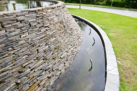 Stone For Garden Walls by Decorative Fountain Wall With A Slate Stone In The Garden Stock