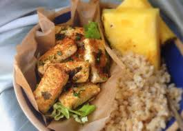 hawaiian style fried tofu with coconut rice and a pineapple slice