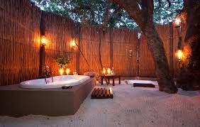 impressive outdoor bathroom ideas with high bamboo fence and oval