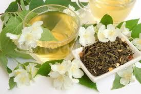 Jasmine Tea Flowers - organic jasmine tea leaves with fresh jasmine flowers and cups of