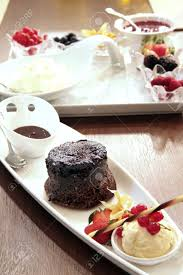 moist chocolate cake with rich chocolate sauce and a scoop of