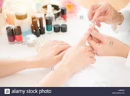 nail treatment manicurist polishing fingernails after painting