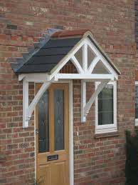 a wide pitched timber door canopy kit ready for felt slates