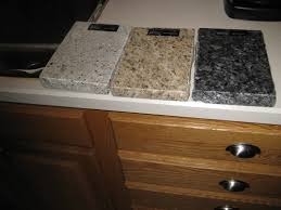 what color granite goes with cabinets granite with oak what color light or