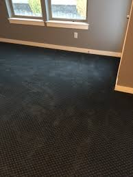 help my brand new black carpet looks green and blue