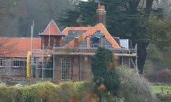 roofers apply lead flashings to anmer hall prior to the new