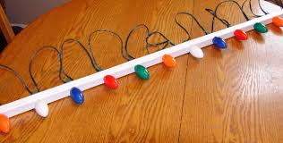 best way to hang christmas lights how to hang christmas lights the easy way rustic refined