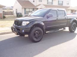 nissan frontier king cab 4x4 black nissan frontier lifted with bull bar new truck ideas