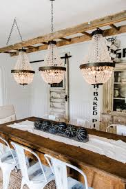 Light Fixture For Dining Room The Chandeliers Are Hung Liz Marie Blog