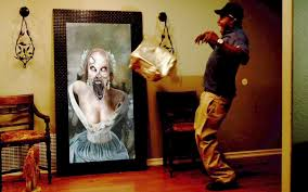 Halloween Scare Pranks 2013 by Woman Pranks Delivery Guys With Ghostly Setup Horror Movie News