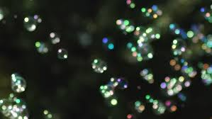christmas tree shaped sparklers on black background stock footage